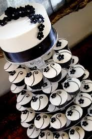 Black and white wedding cupcakes. I'd like to add in some red to this idea too...