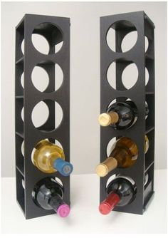 """Rutherford Wine Rack - Set of Two (Black) (21""""H x 5""""W x 5.5D) by Proman. $64.02. Horizontal or vertical. Made from oak veneer. Size: 21""""H x 5""""W x 5.5D. Color: Black. Holds up to 10 bottles. Add attractive wine storage to your home with the black Rutherford Wine Rack - Set of Two! This set of two wine racks can hold up to ten bottles of wine, perfect for a small collection in the dining room! Made from oak veneer, these racks are very sturdy and will maintain their attract..."""