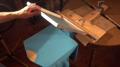 Make a screen printing press to print t shirts for almost nothing. I built this one out of scrap wood and a few things from the hardware store. I do screen p...