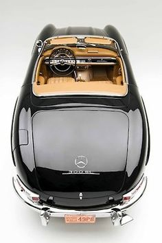 A beautiful angle to photograph this Mercedes 300 SL showing its gorgeous curving rear.  And the color combination....perfect!