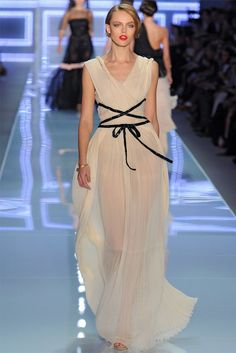 this is a picece from Christian Dior at Spring 2012 Paris Fashion Week and WOW! what a dress! so simple yet such an elegant, flowy, classy, gorgeous dress. The color is great and the tie in the front allows it to adjust to the shape of you  a little more which is really nice!