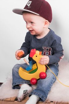 A wooden ecological toy on a string Pull Toy, 1 Year Olds, Paint Finishes, Motor Skills, First Step, Your Child, Your Pet, Red And White, Toys