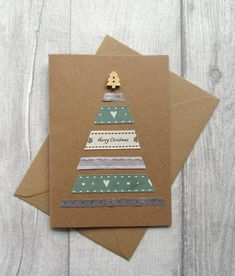 · A modern handmade Christmas card featuring a Christmas tree created from ribbon and topped with a cute wooden button. Send those you love something special this holiday season. Each design is lovingly… Simple Christmas Cards, Ribbon On Christmas Tree, Homemade Christmas Cards, Homemade Cards, Handmade Christmas, Christmas Fun, Holiday Cards, Xmas Cards Handmade, Personalised Xmas Cards