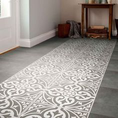 A traditional looking grey patterned feature floor tile designed with a subtle stone effect for added authenticity. For use in the bathroom, kitchen and bedroom this Devonstone black patterned ceramic tile is a square 331x331mm.