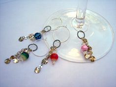 Hey, I found this really awesome Etsy listing at https://www.etsy.com/listing/196100318/wine-charm-set-of-four-4-beaded-wine