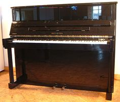 A 1994, Bechstein Studio 120 upright piano with a black case and polyester finish at Besbrode Pianos