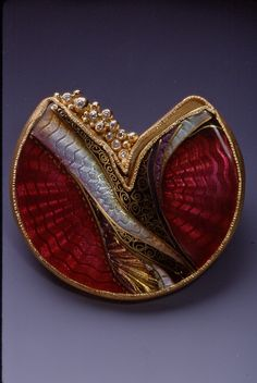 "This brooch was created by Marilyn Druin (1941-2001) in 2000. ""Some artists are social commentators. They interpret and comment upon life.... I try to take some of earth's essential elements and create my own world with order and harmony where my mind can be at peace."" - Marilyn Druin, 1999"