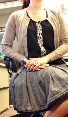 Full pleated, plaid skirt with a scroll print top tunic from @Golden Tote, lovely studded brogues, and an oatmeal cardi #ootd #whatIwore YesAndNazzy (at the office)