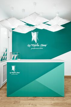 La Muela Shop / parafarmacia dental Graphic & Interior Design by Jiménez De Nalda