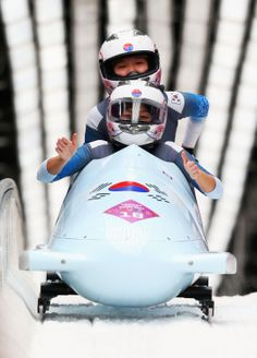 Sunok Kim (front) and Mihwa Shin of Korea team 1 compete during the Women's Bobsleigh (c) Getty Images Bobsleigh, Motorcycle Helmet, Olympic Games, Olympics, Skiing, Athlete, Korea, Winter, Hs Sports