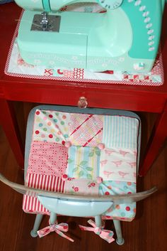 a little sewing space Love This - both, seat cushion and place mat for sewing machine, not to mention that teal machine :)