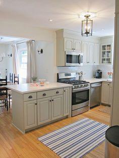 Benjamin Moore Senora Gray cabinets, White Dove walls, Lantern, Dash & Albert Lighthouse Rug, ORB pulls, glass front cabinets