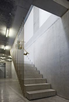 Deruyte Childrens Shoe Shop by ONO Brass and concrete staircase