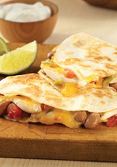 Spice up your summer dinner with this delicious Chicken and Bean Quesadilla recipe!