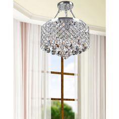 @Overstock - Nerisa 4-light Chrome Semi-flush Mount Crystal Chandelier - The Nerisa semi-flush mount chandelier showcases a stunning chrome finish that is sure to add a sophisticated touch to any living space. This contemporary four-light fixture delights with glinting crystal accents.  http://www.overstock.com/Home-Garden/Nerisa-4-light-Chrome-Semi-flush-Mount-Crystal-Chandelier/8754977/product.html?CID=214117 $133.44