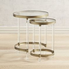 Crafted of clear acrylic, our nesting tables have an airy quality that gives them a light touch that works in modern and traditional settings. With sleek lines and golden iron rims, they double the serving capacity when needed, then convert back to a space-saving footprint.