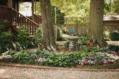A Courtyard Effect Works Well in Level Yards: Backyard Landscaping Ideas --> http://www.hgtvgardens.com/photos/landscape-and-hardscape-photos/backyard-landscaping-ideas?s=5&soc=pinterest