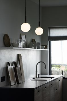 New lighting from Nuura - dark interiors - minimalist pendant light