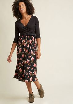 <p>Reading a passage from your latest book is a breeze with this black midi dress in the equation! The surplice neckline, 3/4-length sleeves, and pink floral-printed skirt of this belted frock captivate your audience from the moment you step on stage, and perfectly complement the narrative craft of your debut excerpt.</p>