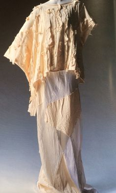 Rei Kawakubo/Comme des Garcon Blouse and Dress. Label: COMME des GARCONS Spring/Summer 1983. Off-white cotton jersey blouse with cotton ribbon applique; washed white patchwork dress of sheeting and rayon satin.