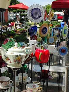 Yard decor made from vintage pots and plates