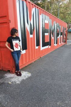 Modeling the El Corazon graphic tee at the I love Memphis mural | ShopMucho Blog