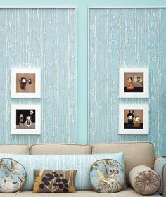 """GENIUS! """"They glued vintage Brunschwig & Fils ikat fabric to quarter-inch foam core, then framed the panels with a simple molding and topped them with four prints."""" Studio Layout, Fabric Panels, Ikat Fabric, Above Couch, Framed Fabric, New Room, Decoration, Home Organization, Small Spaces"""