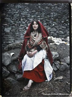 Main O'Toole, a 14 year old girl from a village called the Claddagh wearing traditional Claddagh dress. Galway, Ireland, 26th May 1913. The Claddagh was a tiny fishing village of thatched white stone cottages on the edge of Galway which was knocked down in the 1930s and replaced with council housing and is now part of Galway city centre. Photographer: Marguerite Mespoulet