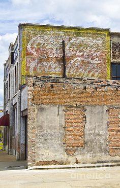 coke sign on side of Hattiesburg building