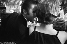 Elvis flirtatiously whispers and shouts in Bobbi's ear at the hotel, Virginia, June 1956.
