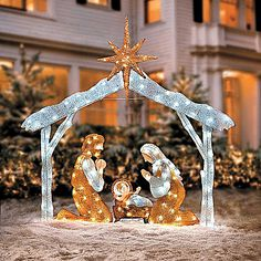 Beautiful lighted outdoor nativity scene lights up a yard for the twinkling tinsel nativity includes mary joseph baby jesus in crche and the stable with star this lovely christmas decoration features white led aloadofball Gallery