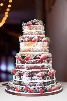 Beautiful naked wedding cake with fresh berries... what a perfect idea for a rustic wedding!  |Photography by Lumaluna Photography|  |Kansas City Wedding Cakes| #munaluchibride #kcweddings #theknot
