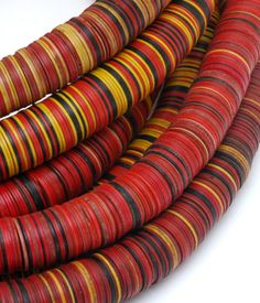 African Vinyl Heishi Mix Lg 12mm.  European traders introduced vinyl heishi to the African market early in the 20th century to offer more color to people who had been traditionally using black coconut shell and white clamshell heishi beads.