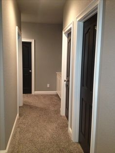Greige walls and Black doors-- i would do grey walls instead Beige Walls, Grey Walls And Carpet, Beige Carpet Bedroom, Dark Carpet, Home Renovation, Home Remodeling, Murs Beiges, Dark Doors, Greige