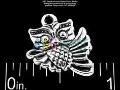 #Charm #Buho #Owl en #Metal color #Plata Antigua de 16x15mm. Bolsita con 5, Código: OWS1615