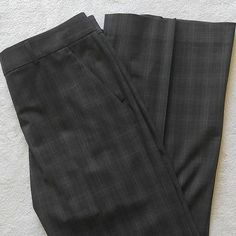 "Theory plaid dress pants Theory career dress pants. Gray plaid. Two slanted side pockets. Zipper with double hook closure and button. Belt loops. Two back slit pockets with buttons. 96% wool, 4% lycra. Size 10. Worn once or twice, like new condition. Measurments laying flat:? Inseam: 31.5""? Waist:16""? Rise: 9"" Theory Pants"