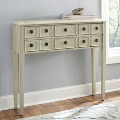 Super slim entry way table.  Perfect for a small space.