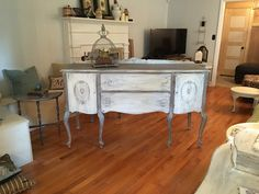 Vintage buffet refinished with Annie Sloan chalk paint colors of old white and coco and heavily distressed. sealed with clear wax and dark wax