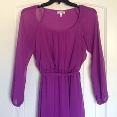 Chiffon Dress. Beautiful purple/mauve dress that is light and airy. Perfect for an engagement party, work party, or a night out in the town.  Long bubble chiffon sleeves give it a flirty feel, while the sash gives form and definition to the body. Sits just above the knees. Worn; in great condition. Lined. Dresses