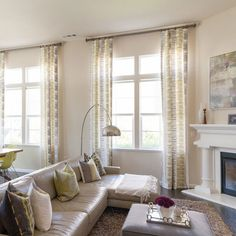 Adding statement window treatments to a living room can rejuvenate a space, not to mention helping insulate a room. And it creates that photogenic diffused light look.