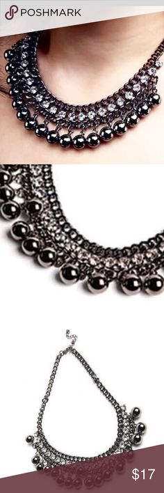 """Vintage Silver/Black Balls Statement Necklace Classy dark silver-tone elegant statement necklace is perfect for such a variety of events, from biker or club wear to date night at the finest of resorts.  Quality 17"""" chain with 2"""" extender.  Chain can adjust longer or shorter.  Between 2 rows of this striking chain is a row of brilliant rhinestones.  A row of fun balls hang from the bottom.  The main deign of necklace is 7"""" long and 1-1/4"""" high.  Comes new with tags in manufacturer packaging."""