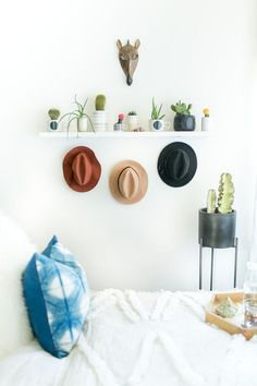 Plants, plants, and more plants! Greenery in a bedroom is a must. It just makes your room feel happy and an inviting space to relax and unwind. We're loving our new cactus wall!