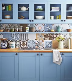 Kitchen wall tiles are perfect to add character to your cooking space. Whether it's a feature splashback or a simple border, there is something for everyone in our collection of kitchen wall tiles. Home Decor Kitchen, Interior Design Kitchen, New Kitchen, Home Kitchens, Funky Kitchen, Blue Kitchen Cabinets, Kitchen Wall Tiles, Yellow Cabinets, Cupboards