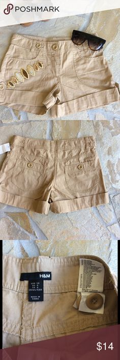 H&M Khaki Shorts (4-6) H&M Khaki Shorts. Size 6. Runs small, IMO. Listing as a 4. Please check measurements to be sure. Approx 14' waist. 4' inseam. Brand new. Never worn. Tags still attached. Super soft!! Please use the offer button & bundle for a bigger discount. Thanks  H&M Shorts