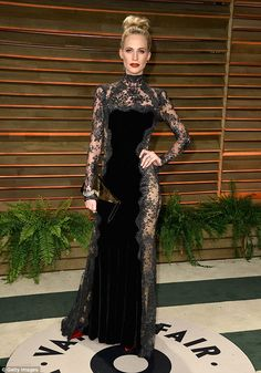 Stunning sister: Poppy Delevingne at the 2014 Vanity Fair Oscar Party in 2014...