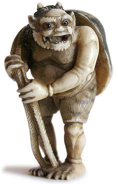 Antique Japanese Ivory Netsuke ~ Oni Carrying Okame Mask ~ Signed: Yasumasa. Circa: 19th Century