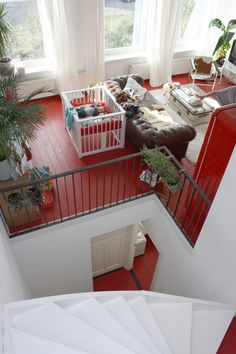 If you're afraid of looking at too much red but want a space infused with it, try Holly Marder's approach in this South Holland home.  The painted red wood floors make a beautiful statement, but since the color is not on the walls and in clear sight-lines, it is slightly more subtle.
