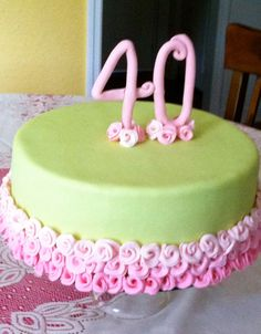40th birthday cake for a special lady. Fondant covered cake with pink fondant roses.