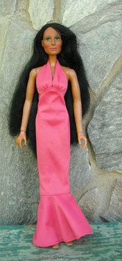 petal pink halter dress. cher, with long hair doll. love the 70s.