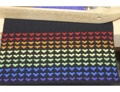 A Weaving Today member created this scarf based on another pattern, creating a cute little rainbow of hearts! Create your own #handwoven scarf just like it! #weaving
